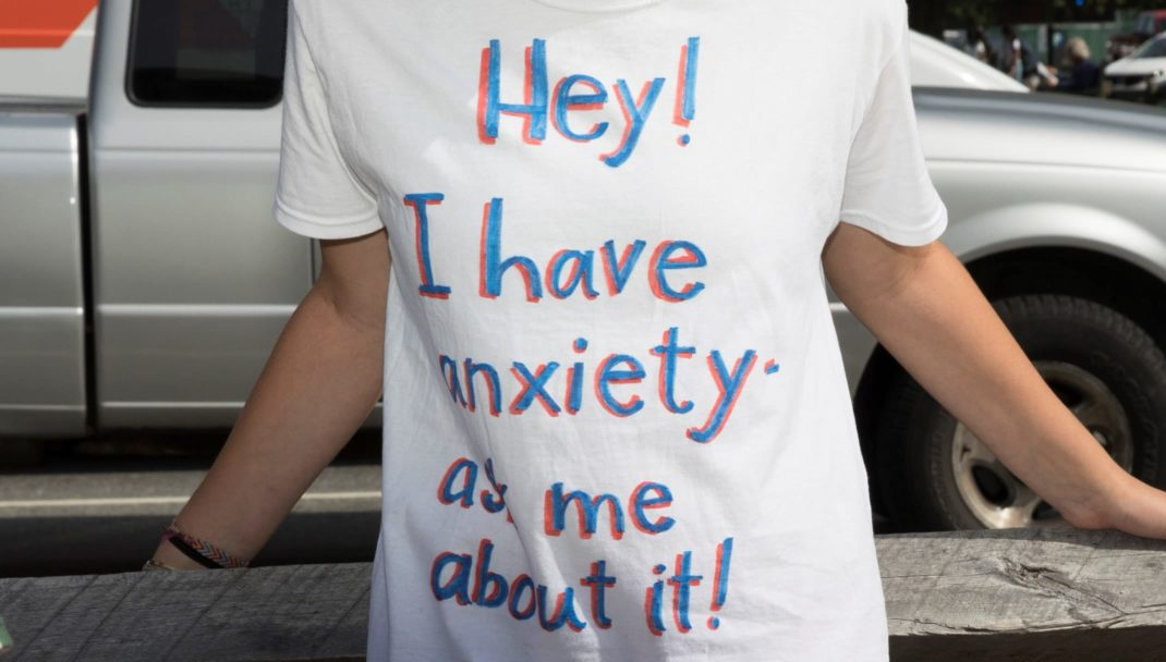 Student wearing a shirt that says Hey I have anxiety, ask me about it