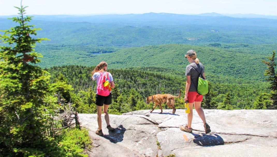 Two hikers in New Hampshire mountains