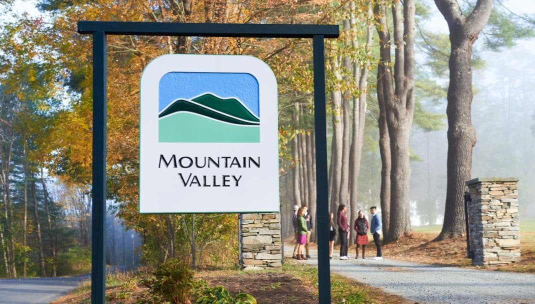 MVTC sign and students walking in the background