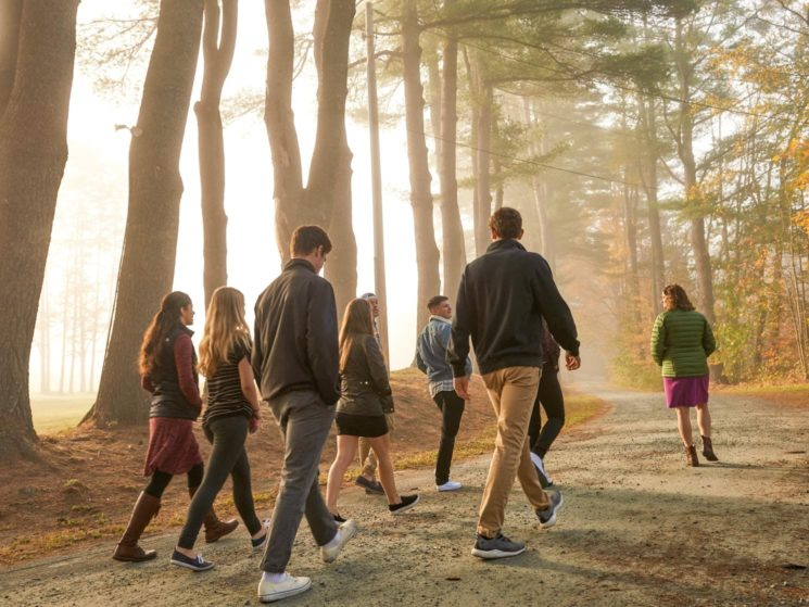 Students and staff going for a walk in the early morning