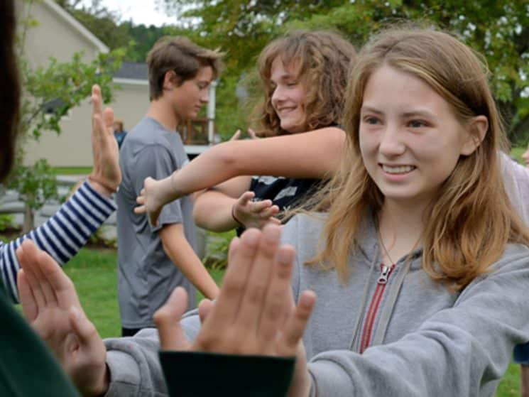 Students touching hands during a team bonding exercise