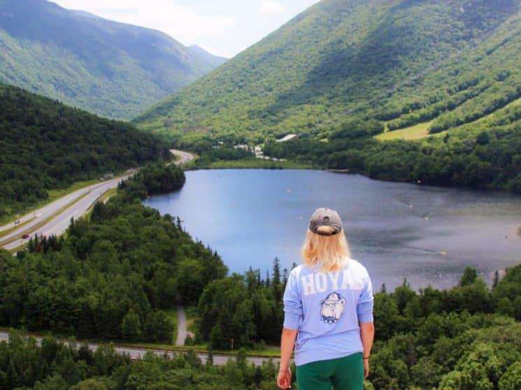 Teenage girl admiring a mountain view